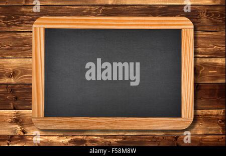 blackboard on a wood background - Stock Photo