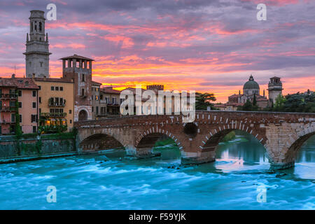 Ponte Pietra bridge at dusk over the Adige river in Verona, Italy - Stock Photo
