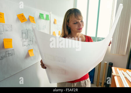 University student of Interior Design doing homeworks, reviewing housing project and completing project. The girl - Stock Photo