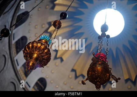 Lamps decorating the Dome of the Rotunda of the Church of the Holy Sepulchre in the Old city East Jerusalem Israel - Stock Photo