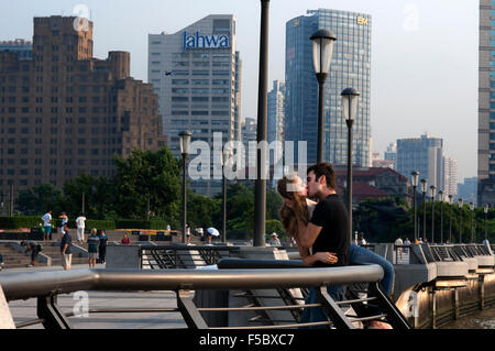 A couple tourists kissing in the Bund. China Love. The Bund promenade, Shanghai, China. China Shanghai Tourist Shanghai - Stock Photo