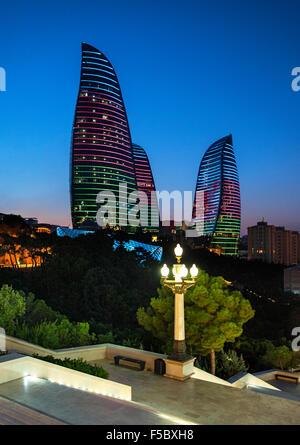 Baku's Flame Towers viewed from Dağüstü park at dusk. - Stock Photo