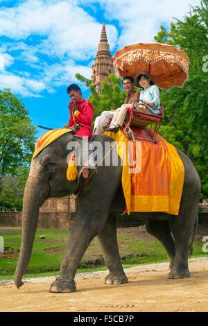 Tourists riding an elephant, Ayutthaya, Thailand - Stock Photo