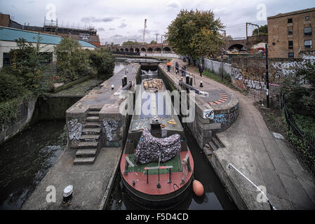 Very large canal barge entering the lock at Hawley Road near Camden Lock in Camden Town, London on the Regent's - Stock Photo