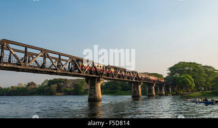Train crossing historical River Kwai Bridge, route from Thailand to Burma, Death Railway, Kanchanaburi Province - Stock Photo