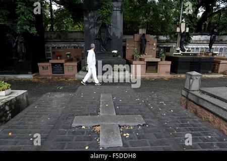 Sao Paulo, Brazil. 2nd Nov, 2015. A man walks in Araca Cemetery during 'The Day of Dead', in Sao Paulo, Brazil, - Stock Photo