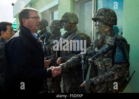 US Secretary of Defense Ashton Carter shakes hands with South Korean Army soldiers during a visit to the Korean - Stock Photo