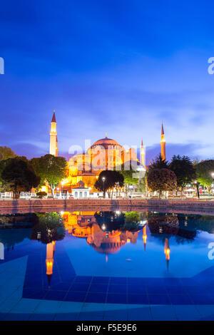 Hagia Sophia (Aya Sofya) (Santa Sofia), UNESCO, reflection at night, Sultanahmet Square Park, Istanbul, Turkey - Stock Photo