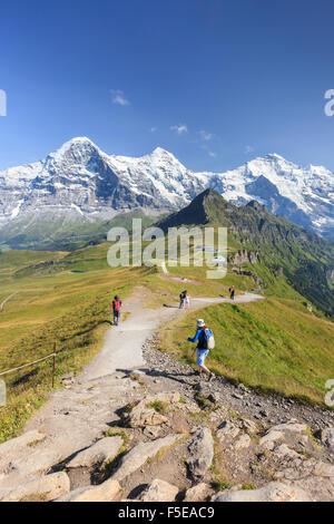 Hikers on the way to Mount Eiger, Mannlichen, Grindelwald, Bernese Oberland, Canton of Bern, Swiss Alps, Switzerland, - Stock Photo