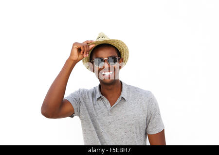 Close up portrait of a cheerful african american guy smiling with hat and sunglasses on white background - Stock Photo