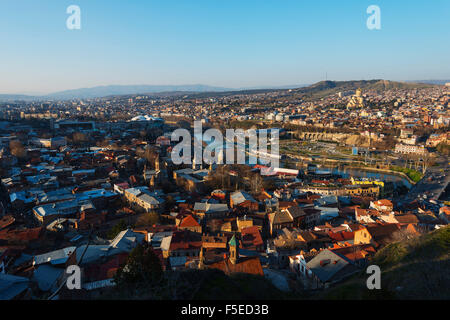 City view, Bridge of Peace on Mtkvari river, Tbilisi Sameda Cathedral and Presidential Palace, Tbilisi, Georgia, - Stock Photo