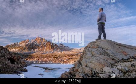 Man looking at mount humphreys, Sierra National Forest, California, USA - Stock Photo
