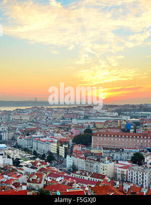 View of Lisbon city center and 25 April Bridge at sunset, Portugal - Stock Photo