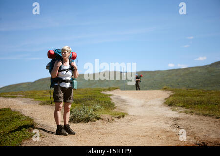 Sweden, Jamtland, Two hikers on footpath - Stock Photo