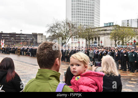 Birmingham, UK. 08th Nov, 2015. Remembrance Sunday: A young girl attends Remembrance Sunday with her father in Birmingham. - Stock Photo