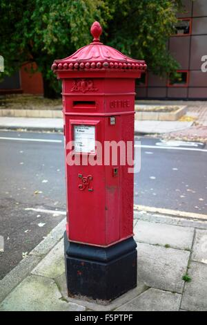 Victorian six sided red Post Office pillar box - Stock Photo