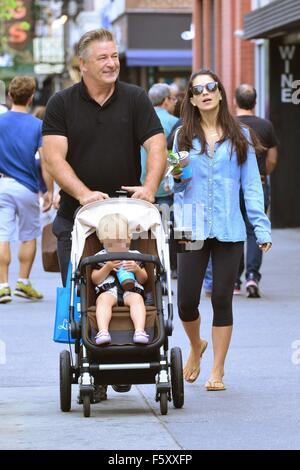 Alec Baldwin and wife Hilaria Baldwin take their daughter, Carmen, out for a stroll in SoHo  Featuring: Alec Baldwin, - Stock Photo