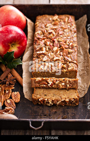 Gingerbread apple loaf cake with cinnamon and nuts - Stock Photo
