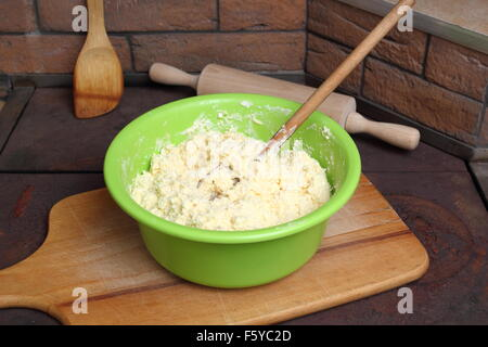 Making Cottage Cheese Pancakes. Batter in bowl. - Stock Photo