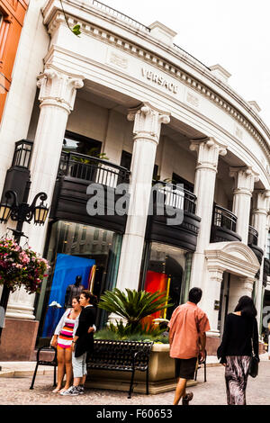 Tourists taking photos on Via Rodeo off Rodeo Drive in Beverly Hills California - Stock Photo