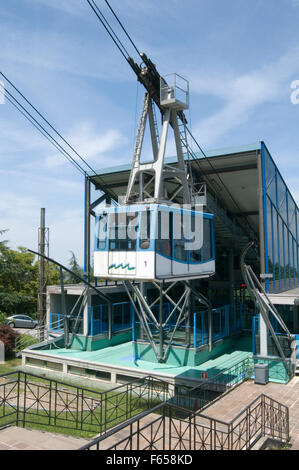 cable car car cablecar cablecars wire wires cables tension stress force forces stress strain san marino lift lifting - Stock Photo