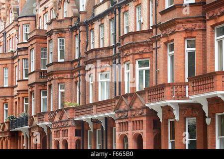 Red bricks English houses facade in London - Stock Photo