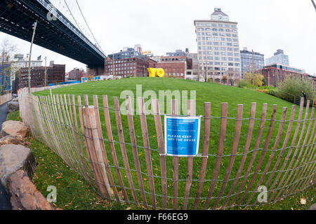 The bright yellow OY/YO public art sculpture in Brooklyn Bridge Park in New York on Thursday, November 12, 2015. - Stock Photo