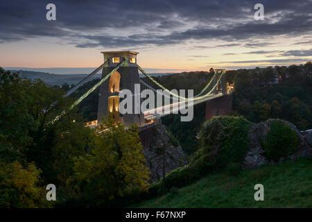 Clifton Suspension Bridge in Bristol illuminated at night. - Stock Photo