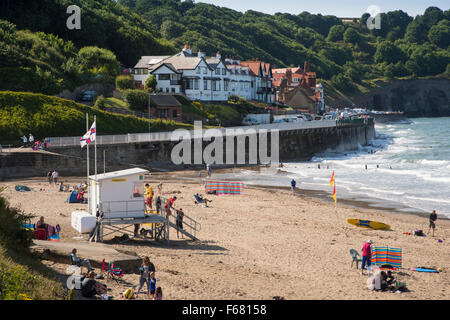 Summer view of sunny Sandsend, North Yorkshire, England, UK - people on holiday & RNLI lifeguards who patrol the - Stock Photo