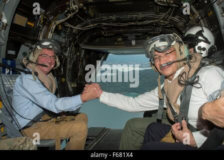 U.S. Secretary of Defense Ash Carter shakes hands with Malaysian Minister of Defense Hishammuddin Hussein as they - Stock Photo