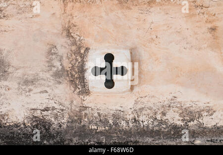 Cross orthodox Christian religious symbol on a church wall - Stock Photo