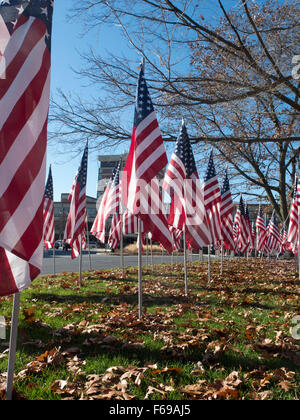 Rows of flags honoring US Veterans stand on display at Park Square in Pittsfield, MA. - Stock Photo