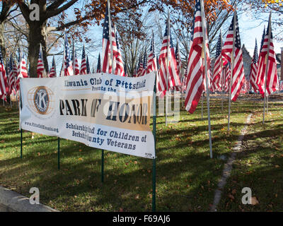 Banner for Kiwanis Club of Pittsfield, Ma in Park Square, display of flags for US Veterans. - Stock Photo