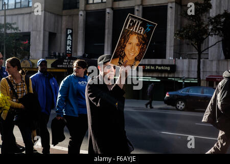 New York, New York, USA.  November 15, 2015:  Man holds up a 'Remembering Ella' sign during march. - Stock Photo
