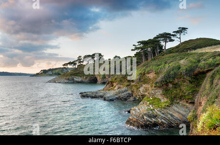 The South West Coast Path at St Anthony's Head looking back to St Mawes with the castle in the far distance - Stock Photo