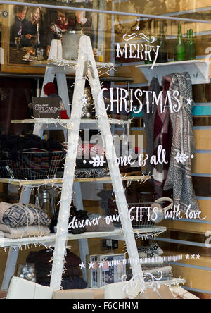 A shop window display with advertisement to draw shoppers attention to their christmas products for sale, Piccadilly, - Stock Photo