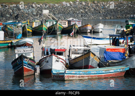 PANAMA CITY, Panama--Small wooden fishing boats on the waterfront of Panama City, Panama, on Panama Bay. - Stock Photo