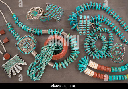 A collection of Vintage Zuni and Navajo Native American Jewelry made of turquoise, silver, pipe stone and Heishe - Stock Photo