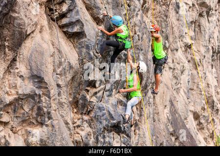 Banos, Ecuador - 30 November 2014: Basalt Challenge Of Tungurahua, Group Of Brave Climbers Climbing A Rock Wall - Stock Photo