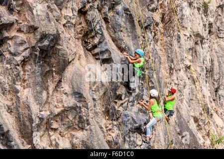 Banos, Ecuador - 30 November 2014: Basalt Challenge Of Tungurahua, Young Group Of Climbers Climbing A Rock Wall - Stock Photo