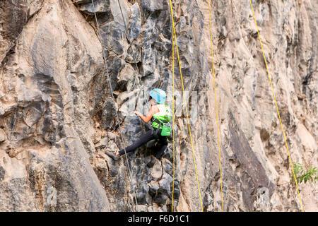 Banos, Ecuador - 30 November 2014: Basalt Challenge Of Tungurahua, Brave Girl Climbing A Rock Wall In Banos On November - Stock Photo