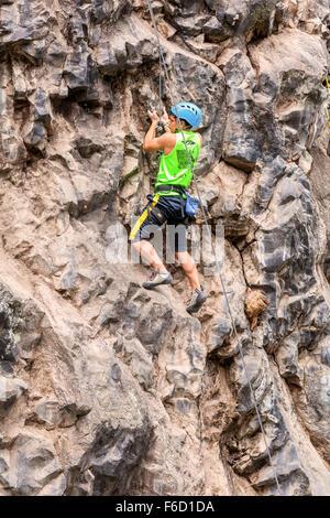 Banos, Ecuador - 30 November 2014: Basalt Challenge Of Tungurahua, Young Man Climbing On A Limestone Wall  In Banos - Stock Photo