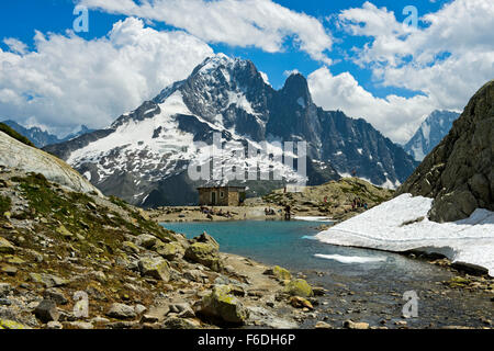 mountain lake Lac Blanc in the Aiguilles Rouges National Nature Reserve, peak Aiguille Verte and Les Drus behind,Chamonix,France - Stock Photo