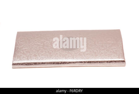 Chocolate bar wrapped in foil - Stock Photo