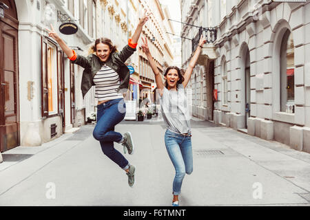Austria, Vienna, two excited female friends in the old town - Stock Photo