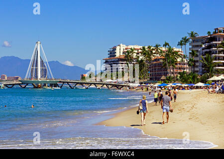 Beach at Zona Romantica, old town of Puerto Vallarta, Mexico with the Los Muertos Pier in the background - Stock Photo