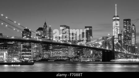 Black and white Manhattan waterfront at night, New York City, USA. - Stock Photo