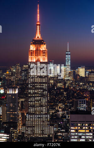 Top view of the Empire State Building with orange lights, Manhattan, New York, USA - Stock Photo