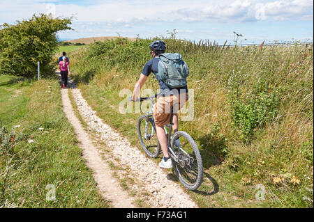 Tourists on South Downs Way in The South Downs National Park East Sussex England United Kingdom UK - Stock Photo
