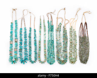 A Collection of Vintage Turquoise Native American Necklaces with Silver Beads and Tortoise Shell Heishe Beads which - Stock Photo